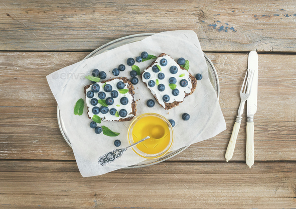 Healthy breakfast set with ricotta, fresh blueberries, honey and - Stock Photo - Images