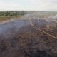 Dry Field Burning Near Settlement - VideoHive Item for Sale