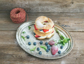 Custard ring pastry filled with cream-cheese, fresh strawberry a