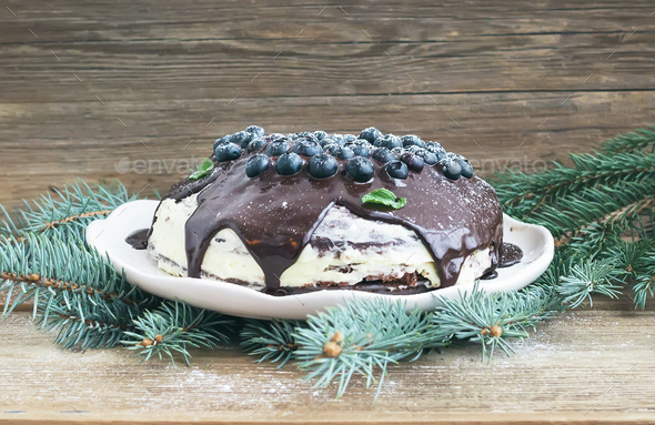Christmas chocolate cake with chocolate ganache, cream-cheese fi - Stock Photo - Images