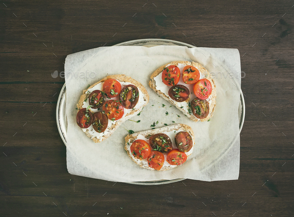 Ricotta and cherry-tomato sandwiches with fresh thyme on a silve - Stock Photo - Images