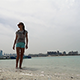 Girl Walking Next to the Sea - VideoHive Item for Sale
