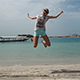 Happy Young Girl Jumping at the Beach  - VideoHive Item for Sale