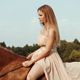 Girl Rides On a Brown Horse In a Meadow - VideoHive Item for Sale