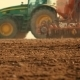 Tractor Plowing Field At Sunset - VideoHive Item for Sale