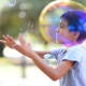 Boy Catching Soap Bubbles - VideoHive Item for Sale
