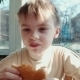 Boy Eating Hamburger In Fast Food Restaurant - VideoHive Item for Sale