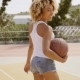 Sporty Young Woman With a Baseball On a Court - VideoHive Item for Sale