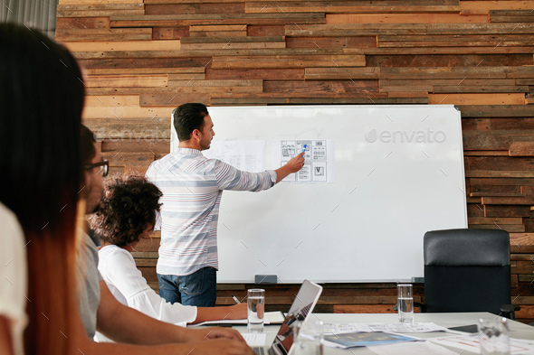 Brainstorming at a meeting room of creative agency - Stock Photo - Images
