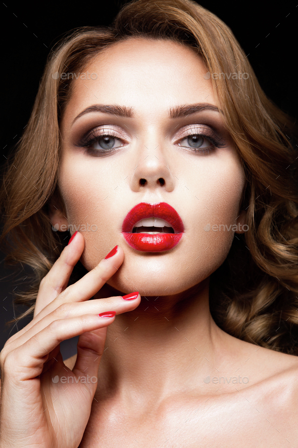 Close-up portrait of beautiful woman with bright make-up - Stock Photo - Images