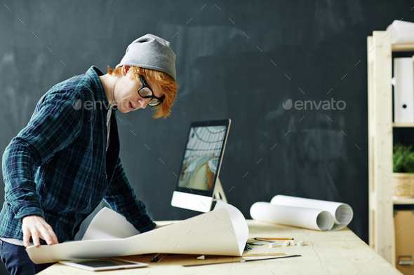 Looking at sketch in blueprint - Stock Photo - Images