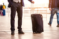 Unrecognizable businessman with luggage waiting at the airport - PhotoDune Item for Sale