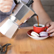 Woman Pouring Coffee from Italian Moka Pot - VideoHive Item for Sale