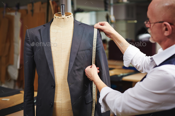 Taking measures from jacket - Stock Photo - Images