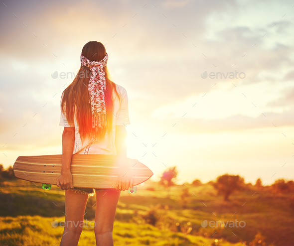 Young Woman with Skateboard - Stock Photo - Images