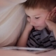 Boy Lying Under Blanket And Watching Cartoon On Touch Pad - VideoHive Item for Sale