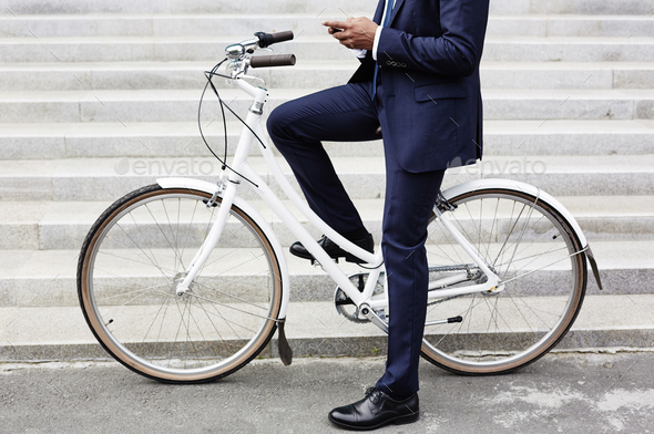 Riding to work on bicycle - Stock Photo - Images
