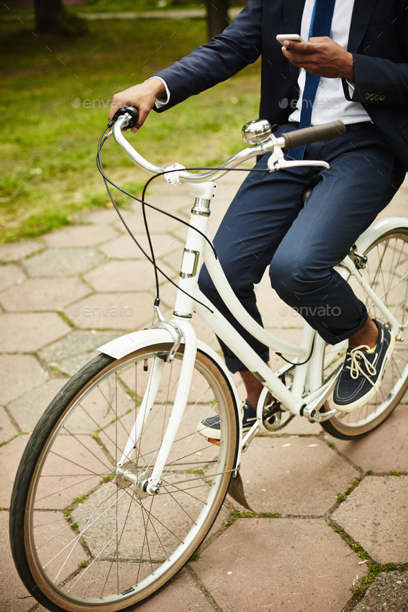 Businessman on bicycle - Stock Photo - Images