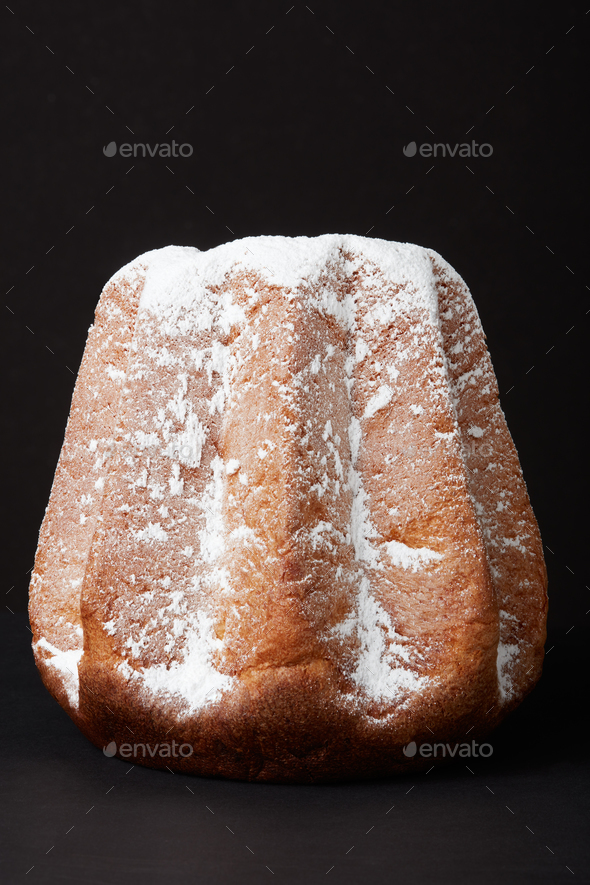 Pandoro, Christmas cake with icing sugar isolated on black, clip