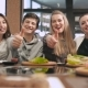 Group Of Friends Showing Thumbs Up In Restaurant - VideoHive Item for Sale