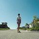 Woman Down The Road With Skateboard - VideoHive Item for Sale