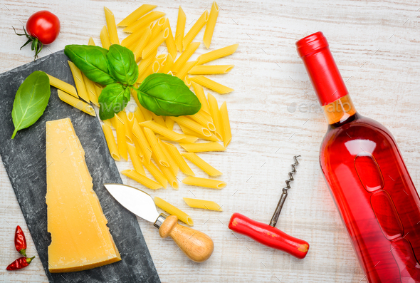 Parmesan Cheese, Penne Pasta and Rose Wine - Stock Photo - Images