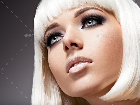Fashion portrait of young beautiful woman with white hairs and b - Stock Photo - Images