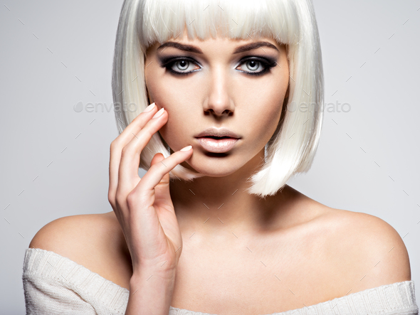 Woman's face with  fashion black makeup of eye and long black ey - Stock Photo - Images