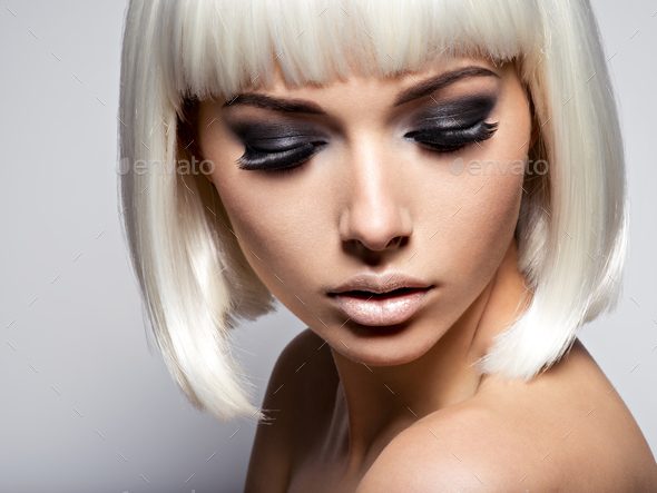 The girl's face closeup with long black lashes. fashion makeup - Stock Photo - Images