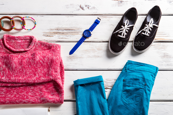 Pink sweatshirt with turquoise pants. - Stock Photo - Images