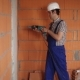 The Electrician Performs Electrical Installation Using a Drill - VideoHive Item for Sale