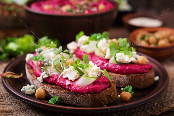 Vegan sandwiches with beetroot hummus, cucumber and blue cheese - Stock Photo - Images