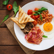 English breakfast - fried egg, beans, tomatoes, mushrooms, bacon and toast. Top view - PhotoDune Item for Sale