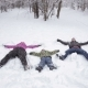 Family Making Snow Angel, Laying Down On Snow - VideoHive Item for Sale