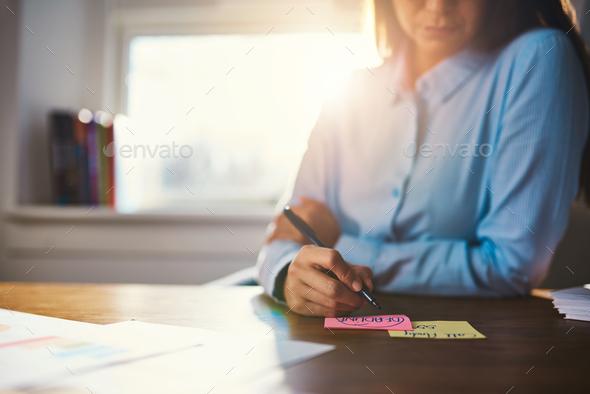 Closeup business woman writing notes - Stock Photo - Images