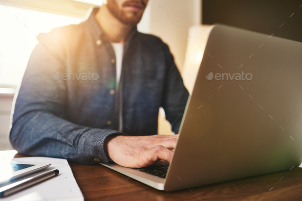 Businessman typing in data on the computer - Stock Photo - Images