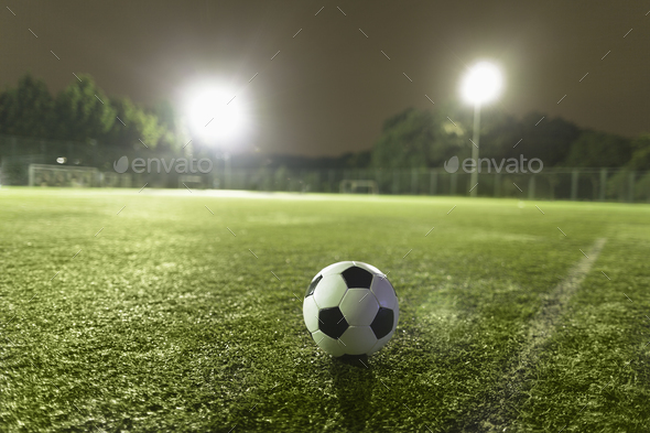 Soccer ball on sports field - Stock Photo - Images