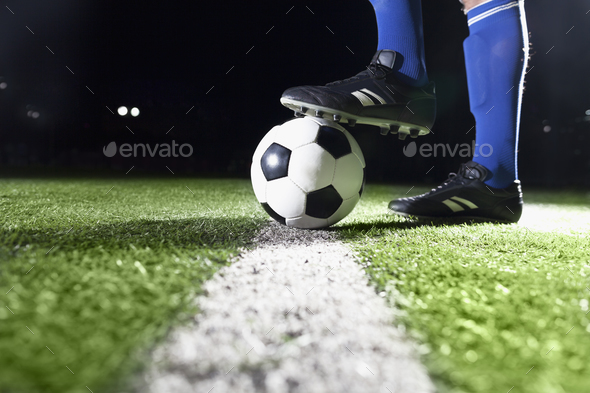Foot on soccer ball - Stock Photo - Images