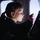 A Girl Enjoys The Tablet In The Aircraft  - VideoHive Item for Sale