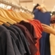 Young Woman Choosing Clothes In Shopping Mall - VideoHive Item for Sale