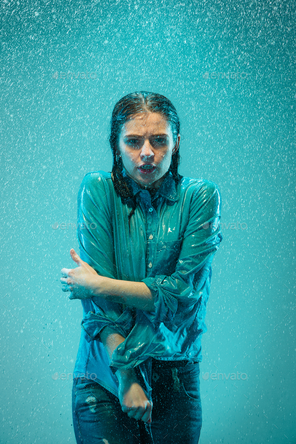 The portrait of young beautiful woman in the rain - Stock Photo - Images