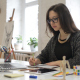 Writing Girl in Designer Office - VideoHive Item for Sale