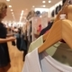 Woman Choosing Clothes In Shopping Mall - VideoHive Item for Sale