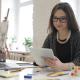 Female Designer Surfing Online on Tablet PC - VideoHive Item for Sale