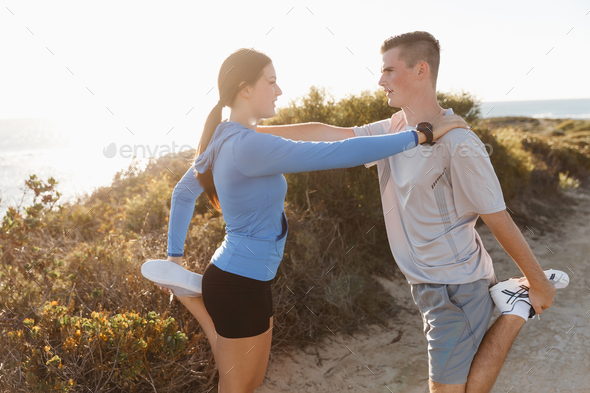 Young couple on beach training together - Stock Photo - Images