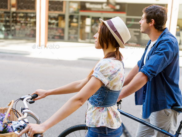 Happy couple in city with bike - Stock Photo - Images
