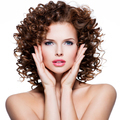 Beautiful sensual woman with brunette curly hair. - PhotoDune Item for Sale