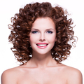 Beautiful smiling woman with brunette curly hair. - PhotoDune Item for Sale