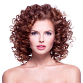 Beautiful woman with brunette curly hair. - PhotoDune Item for Sale
