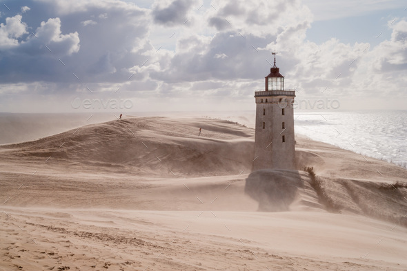 Sandstorm at the lighthouse - Stock Photo - Images